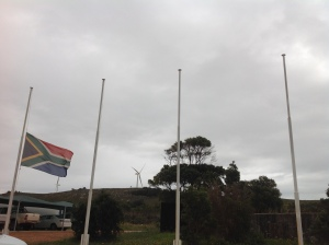 South African flag waving and turbines stopped for Mandela at Jefferys Bay wind farm